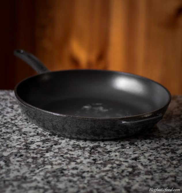 A cast iron pan on a kitchen table.