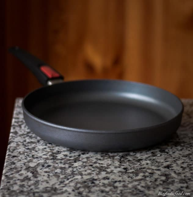 A photo of a non-stick pan on a granite surface.