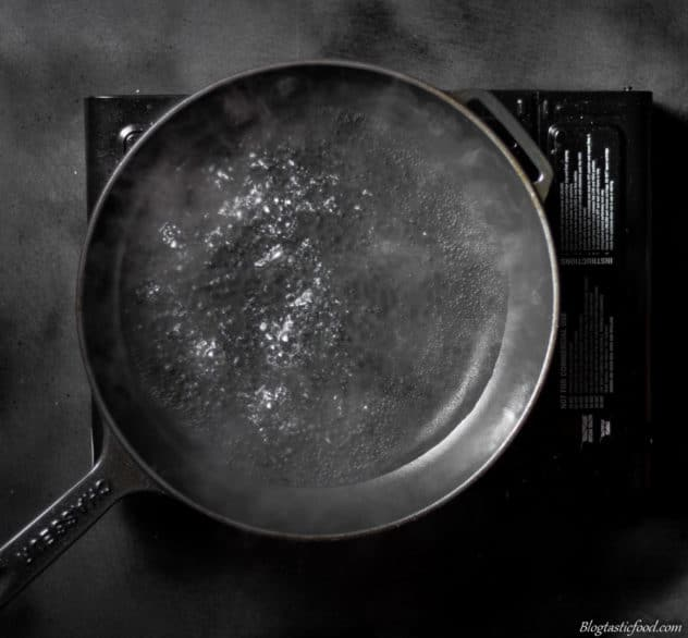 A photo of simmering water in a cast iron pan.