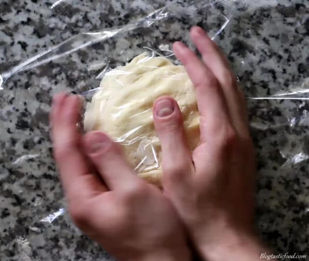 Someone wrapping sweet pastry in cling film.