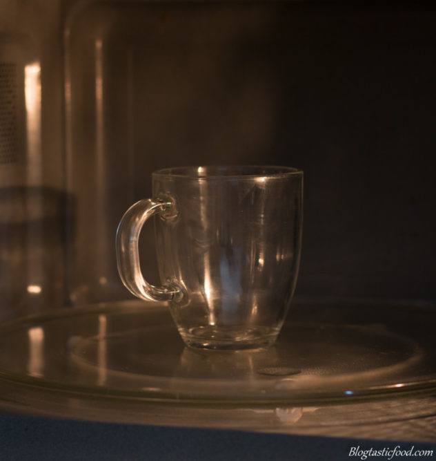 A glass mug in a microwave.