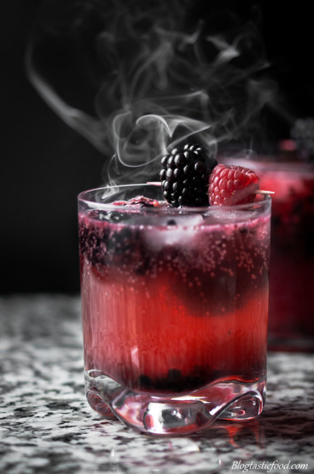 2 black widow cocktails with smoke floating around them.