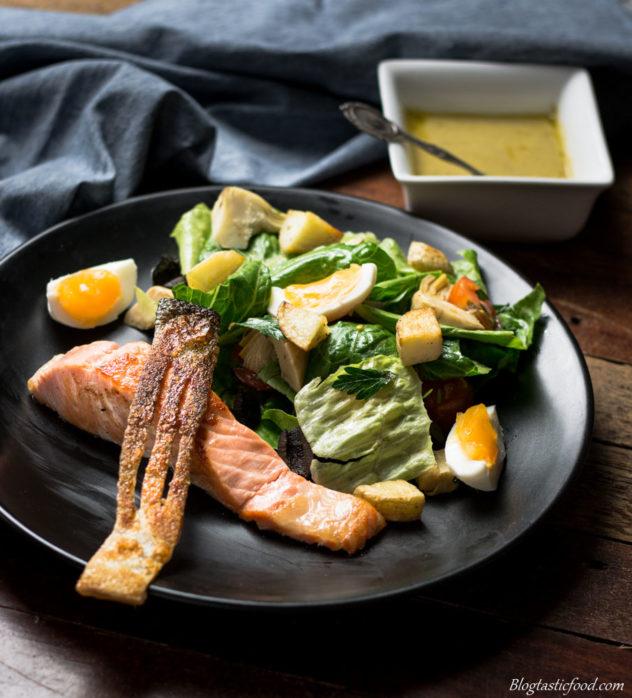 extra crispy salmon skin served with salmon nicoise salad.