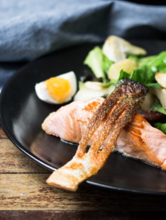 Crsipy salmon skin and pan fried salmon served with a nicoise salad.