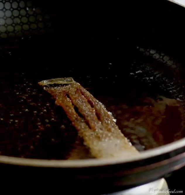 a photo of salmon skin frying in a pan.