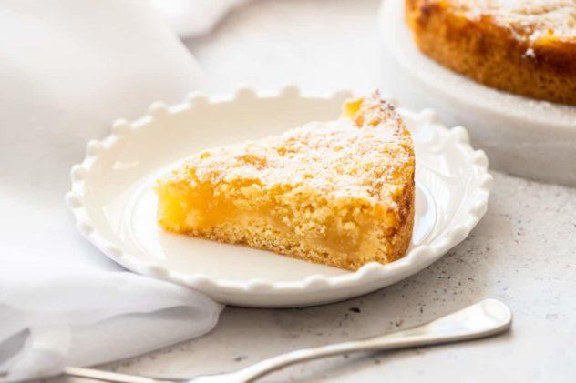 A slice of Belgian lemon tea tacke served in a fancy white plate.