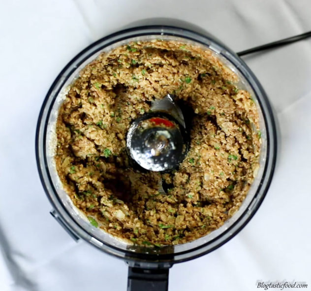 A photo of a processed lentil mixture in a food processor.