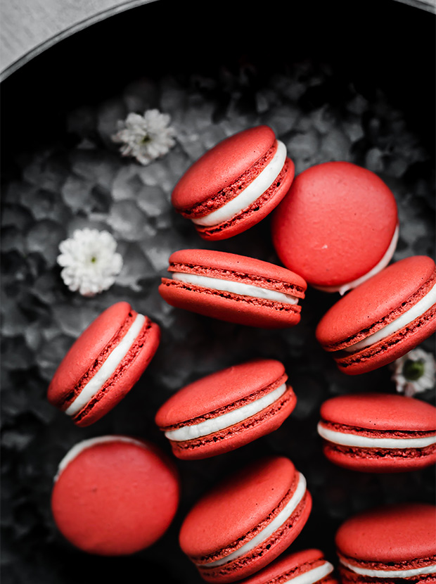 an overhead photo of a bunch of red velvet macarons.