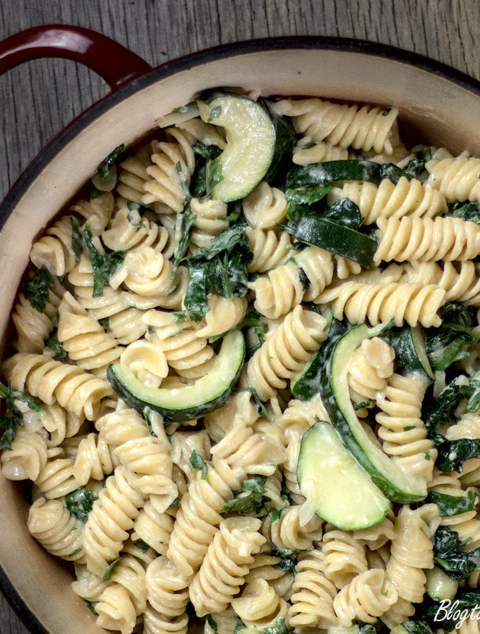 Creamy spinach and courgette pasta in a large pot ready to serve.