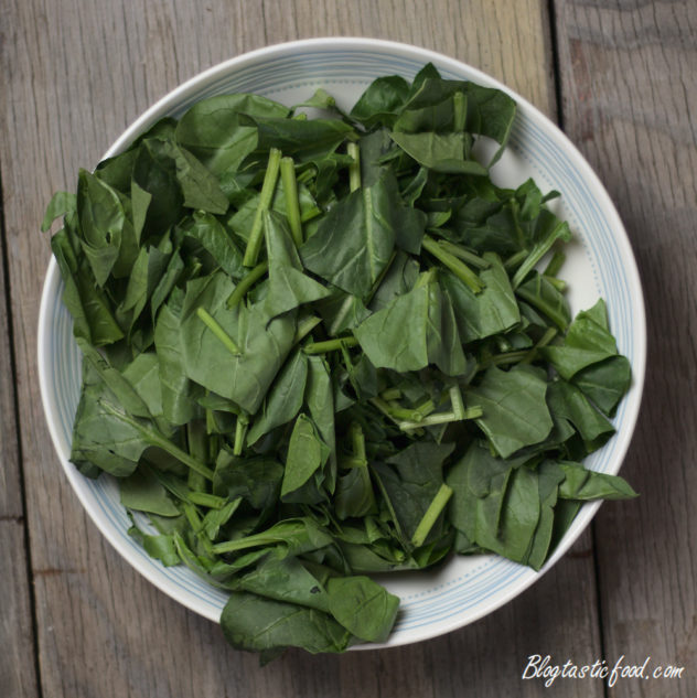 Roughly chopped spinach leaves in a bowl.