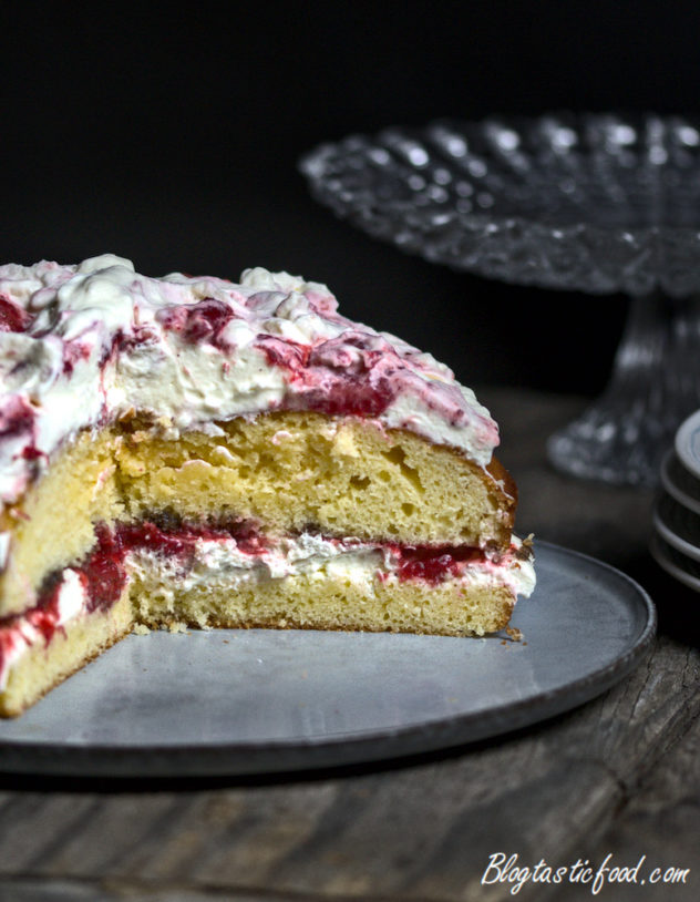 3 quarters of a victoria sponge cake, showing the inside layers.